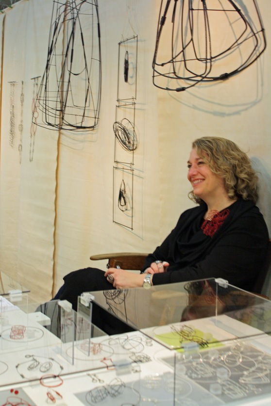 Donna D'Aquino looking lovely in her booth.