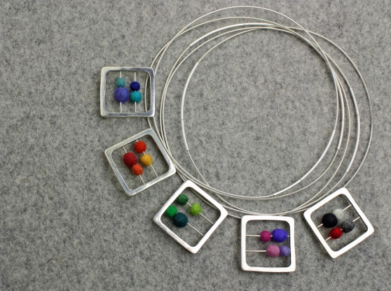 Photo of Cara's Abacus Pendant's/Brooches for a Line Sheet